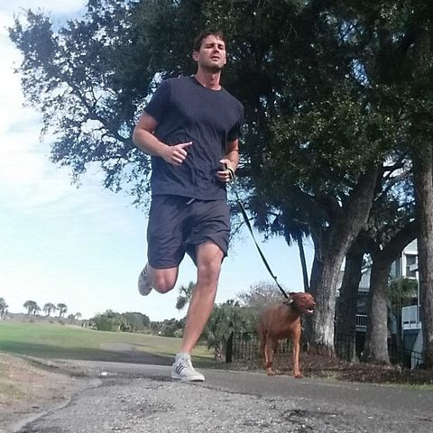 man-with-a-dog-running